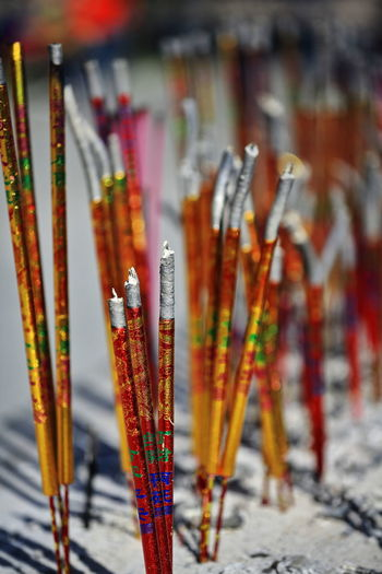 Close-up of paintbrushes in temple
