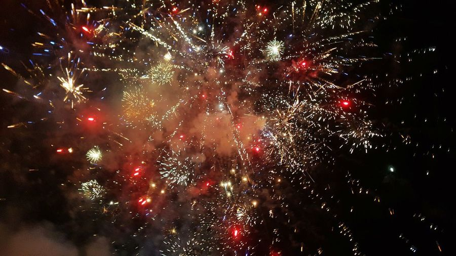 Fireworks New Year's 2016 Exploding Firework Display Celebration Firework - Man Made Object Night Event Arts Culture And Entertainment Long Exposure Glowing Awe Blurred Motion Multi Colored Outdoors Smoke - Physical Structure Low Angle View Motion Illuminated Red No People Sky