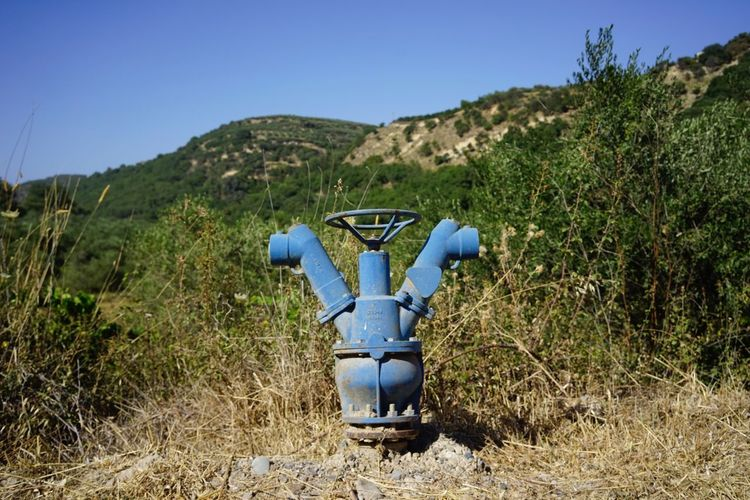 Blue Fire Hydrant Against Mountains
