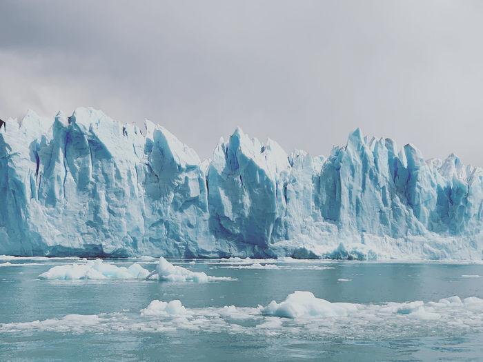 Scenic view of frozen scene at perito moreno glacier against sky