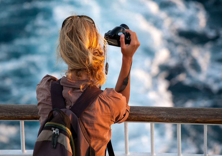 Photogapher Be. Ready. Beautiful Ferry Ferryboat Hope Trip Camera - Photographic Equipment Digital Camera Girl Leisure Activity Nature One Person Outdoors Photographer Photographing Photography Photography Themes Real People Sea Standing Sunset Trip Photo Vacation Water Women