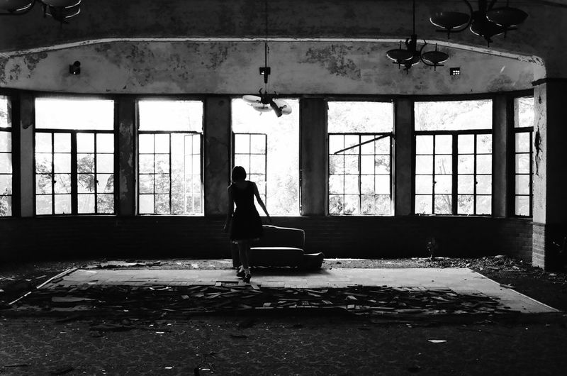 Woman standing in abandoned interior