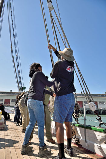 Raising The Sails _ Aboard The Alma 3 The Alma Scow Schooner 80 Ft. Built 1891 Wooden-hulled Flat-bottomed Sailing San Francisco Bay Crew Members My Hiking Group Outdoor Afro Hoisting The Sails Ships Rigging Rope Teamwork San Francisco Maritime National Historic Park National Park Service Ranger Guided Tour National Register Of Historic Places 75000179 A Day On The Bay Heave-Ho