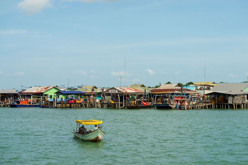 A view of a fishermen's village on stilts besides the sea in Pulau Ketam (Crab Island). This island is famous for sea food products and restaurants. Architecture Beauty In Nature Building Building Exterior Built Structure Cloud - Sky Crab Island Day Fishing Boat House Mode Of Transportation Nature Nautical Vessel No People Outdoors Pulau Ketam Malaysia Sea Sky Transportation Travel Water Waterfront