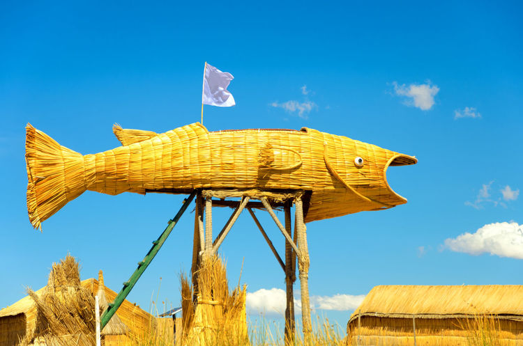 Fish made from reeds in the Uros Floating Islands on Lake Titicaca in Peru Architecture Beach Colorful Decor Decoration Ethnic Floating Houses Inca Isla Island Islands Lake Landscape Manmade Peru Puno Puno, Perú Scene Titicaca Titicaca Lake Totora Tourism Uros Uros Island
