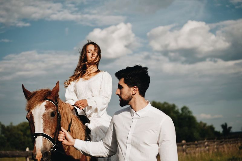 love story of young couple Animal Wildlife Cloud - Sky Couple - Relationship Domestic Domestic Animals Front View Herbivorous Horse Livestock Mammal Outdoors Pets Real People Riding Sky Standing Togetherness Two People Vertebrate Women Young Adult