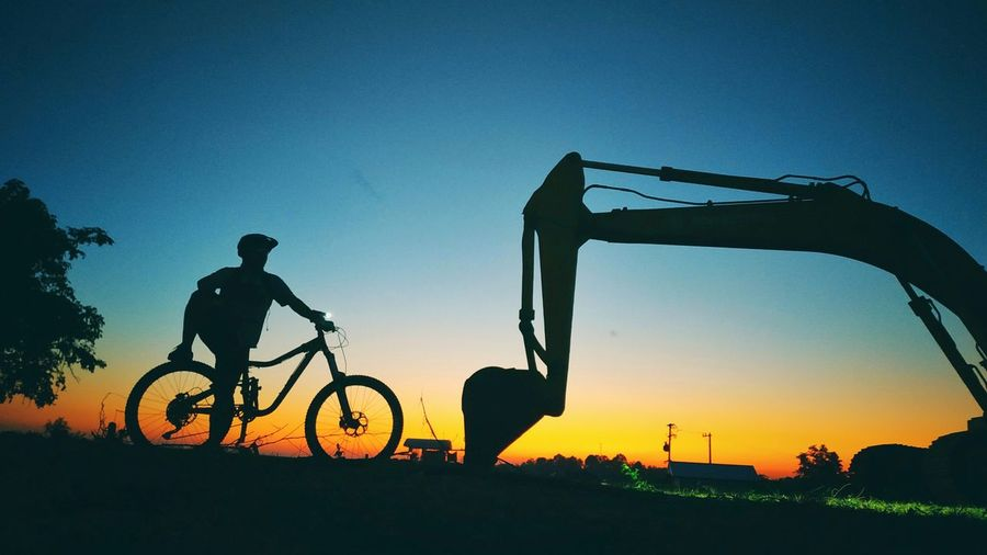 biker Sunset Headwear Men Mountain Bike Bicycle Full Length Silhouette Healthy Lifestyle Sports Helmet Land Vehicle Bulldozer Cycling Cycling Helmet Earth Mover Exercise Bike Pedal Countryside Construction Equipment