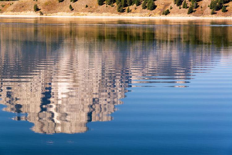Teton Range reflected in Jackson Lake in Grand Teton National Park in Wyoming Alpine Bear Jackson Montana National Park Scenic Snake Tetons Travel Tundra USA Wyoming Destination Forest Grandtetonnationalpark Jackson Lake Landscape Lodge Mountain Overlook Peaks Range Valley Water Wilderness