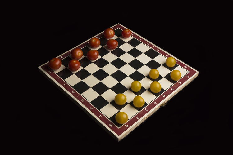 Studio Shot Black Background Leisure Games Board Game Chess Strategy Game Indoors  Large Group Of Objects Chess Board No People Leisure Activity Relaxation Competition Still Life Chess Piece Arts Culture And Entertainment Checked Pattern Arrangement Close-up Tomato