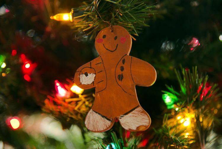 Decoration hanging on illuminated christmas tree