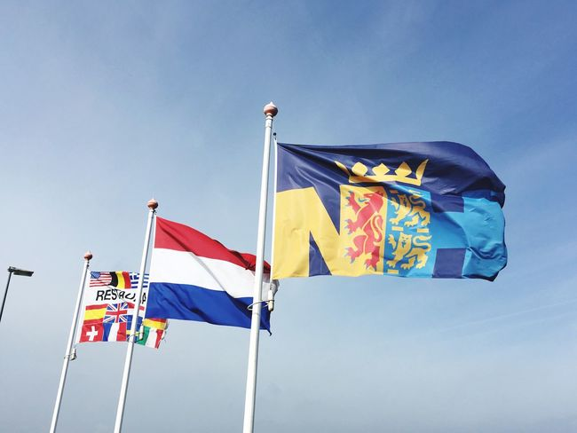 Flags in the wind Netherlands Flags Flags In The Wind  Sky Low Angle View Flag Patriotism Environment Wind Nature No People Waving Multi Colored Day Clear Sky Striped Blue Sunny Outdoors Independence