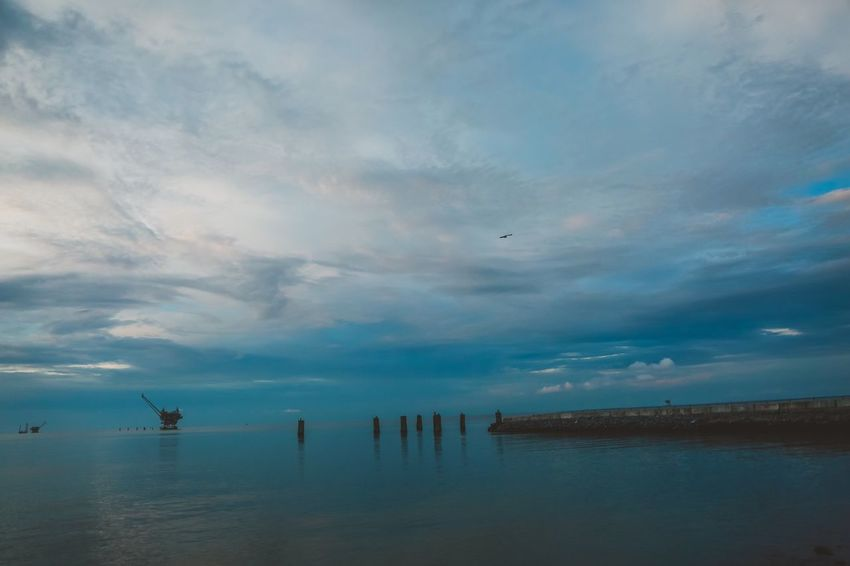 Pier Mobile Bay Alabama Fort Morgan Ocean Clouds Sunset Water Cloud - Sky Sky Scenics - Nature Beauty In Nature Tranquil Scene Sea Tranquility No People Nature Idyllic Horizon Over Water Waterfront Wooden Post Post Horizon Non-urban Scene Reflection Outdoors The Great Outdoors - 2018 EyeEm Awards