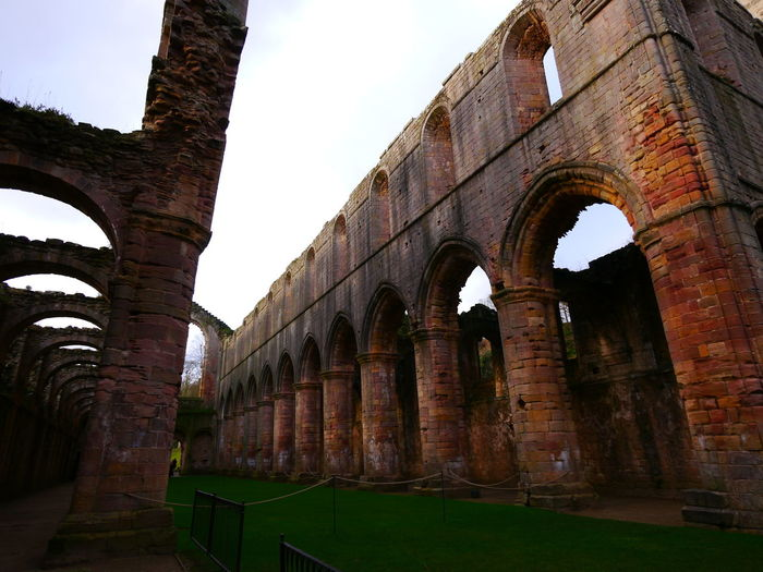 Ancient Ancient Civilization Arch Architectural Column Architecture Built Structure Day December December 2016 Fountains Abbey Fountains Abbey Yorkshire Fountains Abbey, Yorkshire Grass History Low Angle View No People Old Ruin Outdoors Sky Travel Destinations