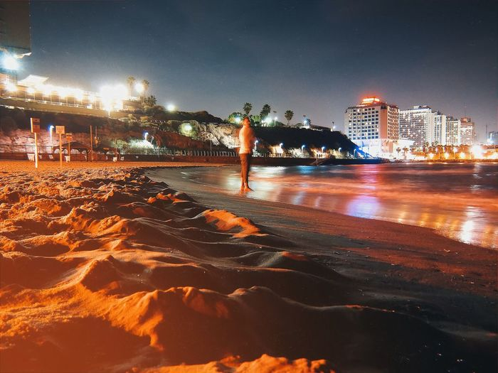 Midnight beach fun... Tel Aviv Israel Night Water Illuminated Beach Sky
