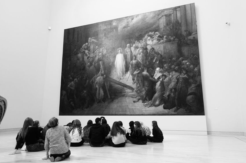 Admiring The View Contrast Perspective Black & White Giant Jesus Jesus Christ Strasbourg Art Arts Culture And Entertainment Awe B&w B&w Photography Black And White Black And White Photography Black&white Blackandwhite Blackandwhite Photography Bnw Bnwphotography Gallery Indoors  Large Group Of People Leisure Activity Lifestyles Painting People Sitting