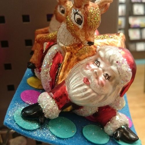 So I saw this yesterday. It's a tree decoration. I think it's supposed to be Santa and Rudolph playing Twister. Odd Treedec Paperchase Santa