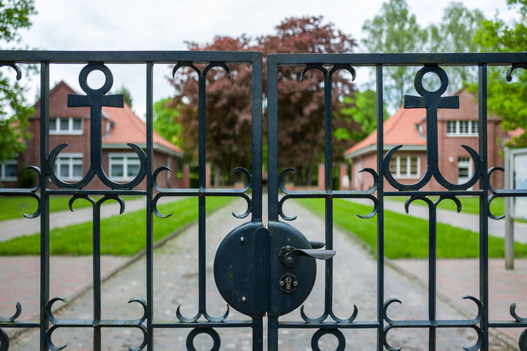 Gate to graveyard Ehrenfriedhof Wilhelmshaven Architecture Barrier Boundary Built Structure Close-up Closed Day Fence Focus On Foreground Gate Iron Iron - Metal Lock Metal No People Outdoors Protection Railing Safety Security Wrought Iron