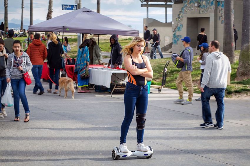 """""""The Rider"""" Segway Scooter Relaxing People Watching Streetphotography Outdoor Photography Street Photography Check This Out Venice Beach Boardwalk Beautiful Girl Photooftheday Enjoying Life Hanging Out Having Fun Cute Girl Recreational Pursuit Hoverboard People Photography Public Girl"""