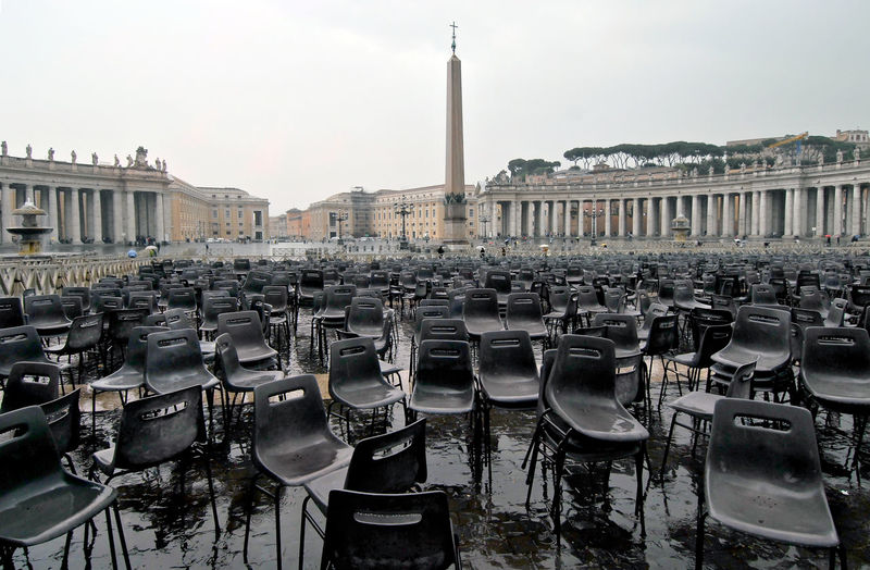 Empty Wet Chairs At St Peter Basilica