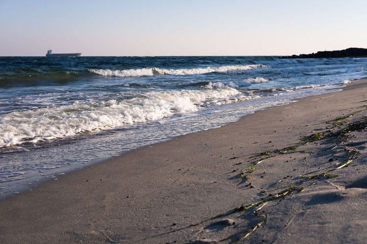 Sea Beach Land Water Sky Wave Motion Horizon Horizon Over Water Nature Beauty In Nature Scenics - Nature Sand Sport No People Aquatic Sport Day Outdoors