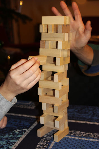 Playing a skill game, building a stack tower with wooden blocks Game Indoors  Two People Gaming Skill Game Skill  Tower Stack Wood - Material Leaning Tower Collapse Fun Leisure Pastime Play Playing Games Playing Two Hands Hands Jenga Jengatower Jenga Game Jenga ♡