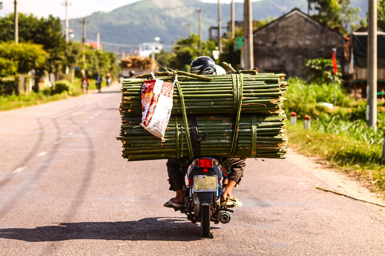 Iconic Vietnamese drivers defying the law of physics just to make deliveries on time. The Week on EyeEm Driver Occupation Vietnamese Driver Vietnames Culture Travel Photography Street Photography Defying Physics Travel Destinations Humorous Iconic Images  Postcard Picture Wanderlust Asian  Asian Way Way Forward Copy Space Countryside Transportation Outdoors Business Finance And Industry Day Road Adult One Person Business Stories An Eye For Travel