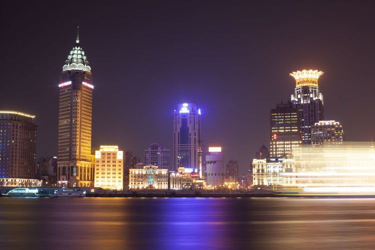 Huangpu River In Front Of Illuminated Cityscape At Night