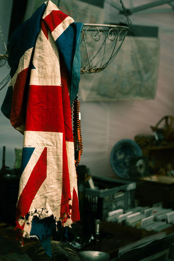 Torn flag hanging at home
