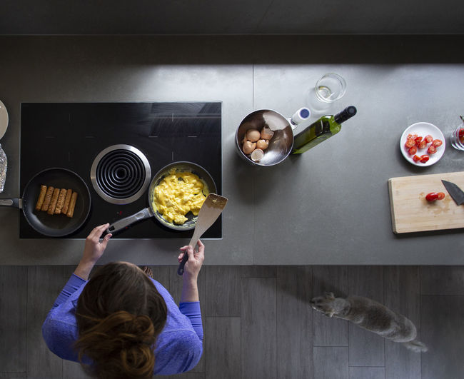 Directly above shot of woman preparing food on table at home