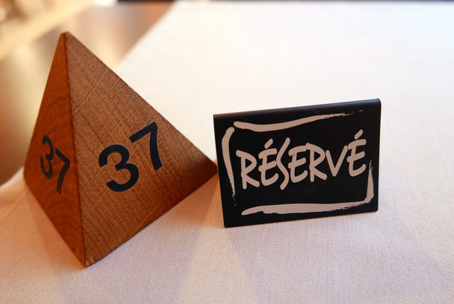 Copy Space Symbol Western Script White Background Number Booked Table Restaurant Luxembourg