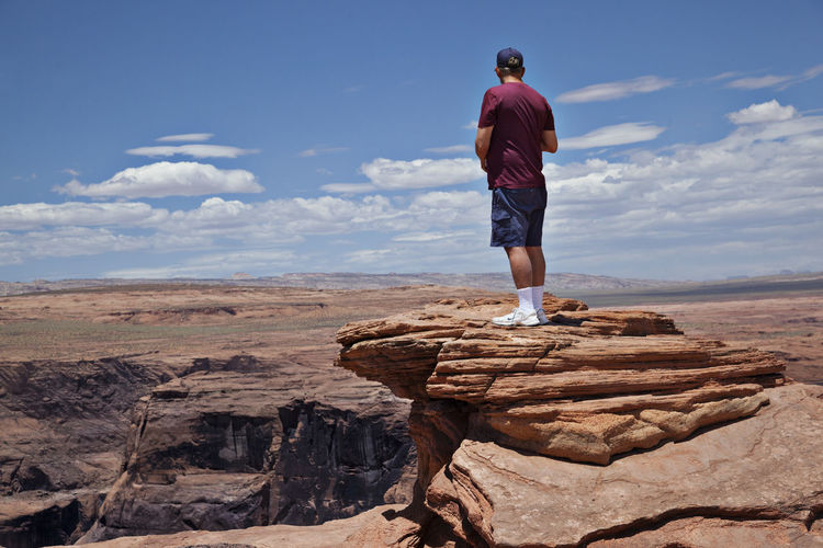 Arid Climate Cliff Desert Desolate Scene Geology Horizontal Composition Nature Outdoors Rock Rock Formation Sand Tranquility Travel Vacation Visitors Clouds And Sky Horseshoe Bay Physical Geography Rough Stone Sunny Day The Edge Of The Cliff Tranquil Scene Vacations