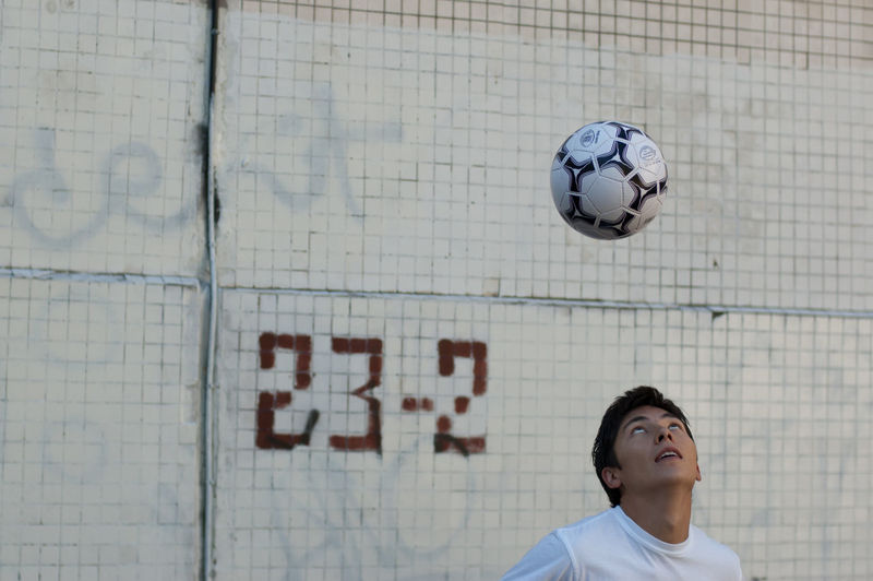 Young Man Playing With Soccer Ball