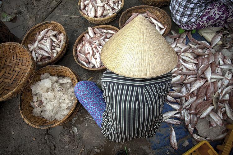 High angle view of man selling fish at fish market