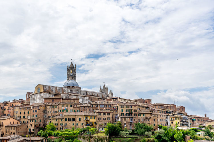 Architectural Feature Architecture Building Exterior Built Structure Capital Cities  Cathedral City Cloud - Sky Cloudy Day Development Duomo Exterior Famous Place History National Landmark No People Outdoors Residential District Siena Sky Spire  Tall - High Tourism Travel Destinations