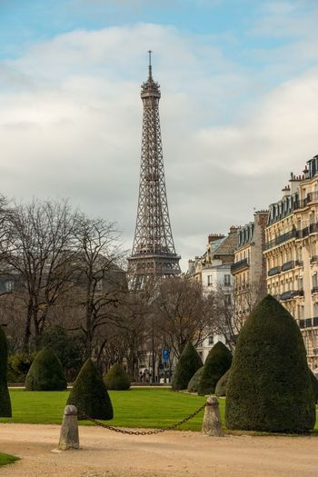 You can see the tower from everywhere Eiffel Tower View Eiffel Tower Eiffel Architecture Tower Built Structure Sky Travel Destinations Tree Cloud - Sky Tourism Outdoors History Building Exterior Day No People Grass City Nature Bare Tree