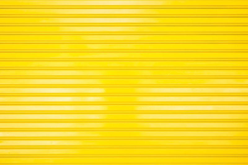 Full frame shot of yellow metal grate
