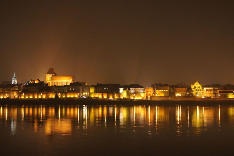 Night Illuminated City Cityscape Travel Destinations Architecture Government Urban Skyline Sunset Politics And Government River Travel Outdoors Sky Built Structure No People Building Exterior Water Toruń Torun, Poland Poland