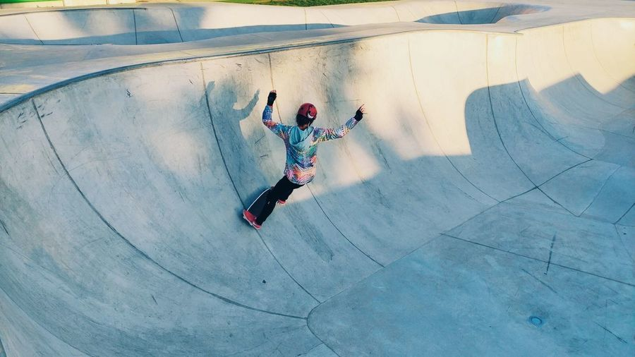High angle view of woman skateboarding