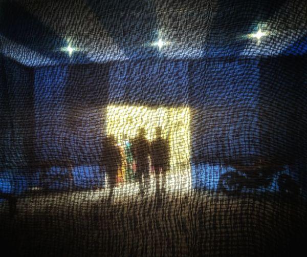 Digital composite image of illuminated light painting on wall