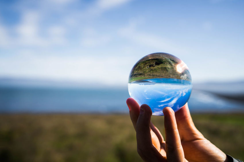 Iceland Iceland Trip Islanda Unrecognizable Person Glass - Material Focus On Foreground Crystal Ball Human Body Part Hand Sphere Nature Blue Water Outdoors Sea Reflection Day Finger