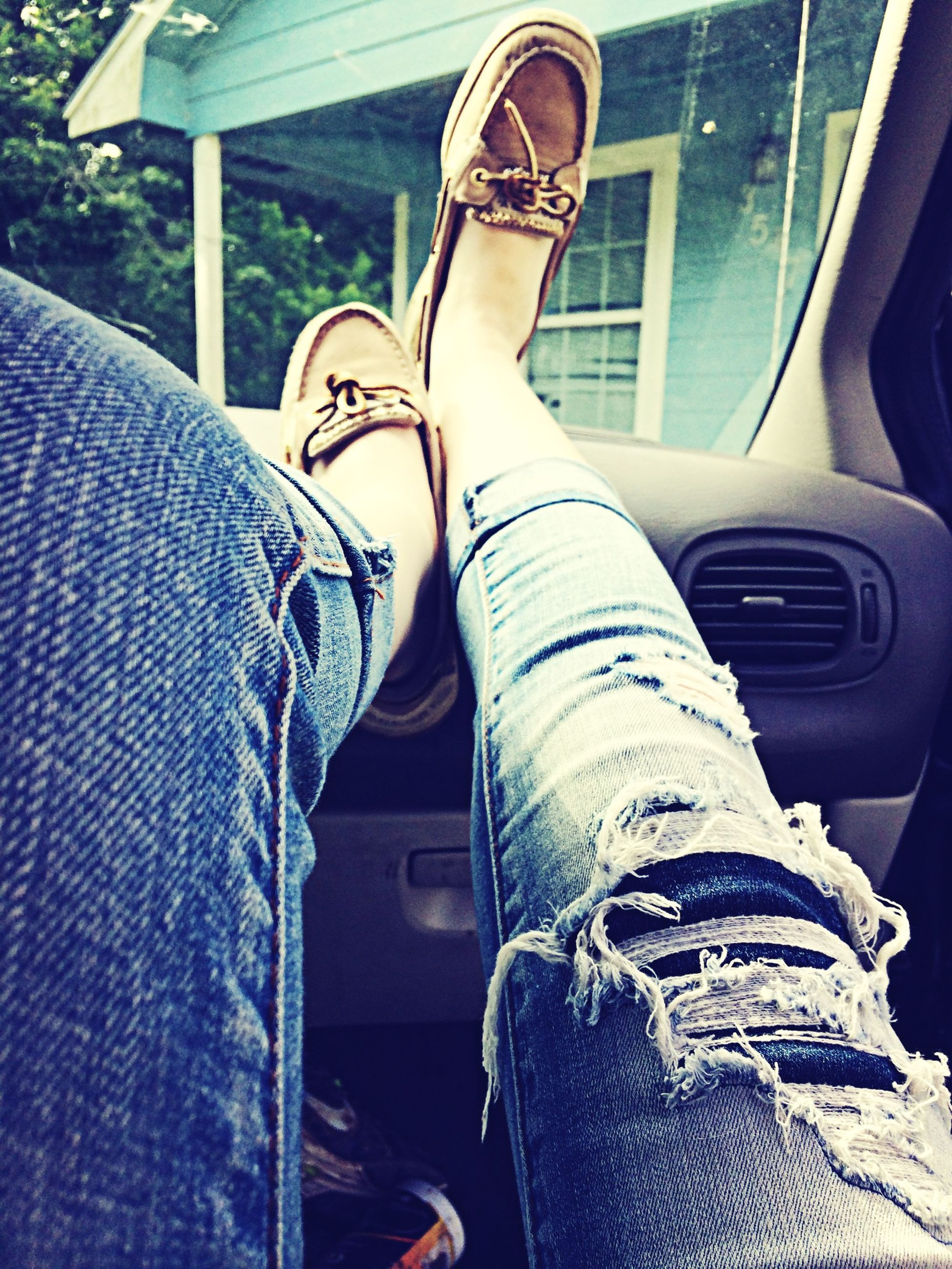 low section, person, shoe, jeans, personal perspective, footwear, human foot, indoors, sitting, canvas shoe, lifestyles, fashion, close-up, standing, legs crossed at ankle, relaxation, denim