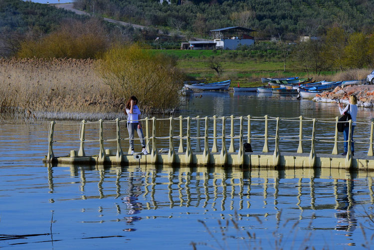 Water Real People Men Lake Reflection Nature Day Lifestyles Waterfront Leisure Activity Casual Clothing Childhood Child People Plant Boys Architecture Full Length Outdoors