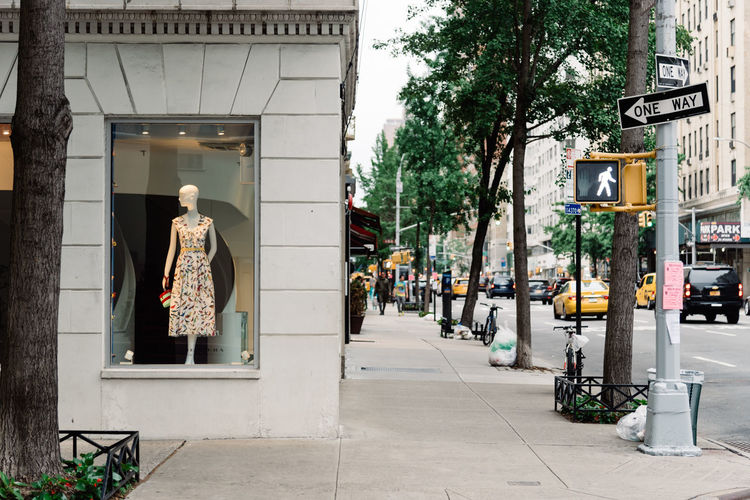 Fashion luxury shops in Upper East Side of Manhattan Architecture Building Exterior City Outdoors NYC Manhattan Shop Storefront People Day Luxury Upper East Side Manhattan  Madison Avenue Commercial Dock Street Building Footpath Sidewalk