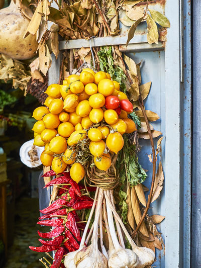 Close-up of fruits hanging in container