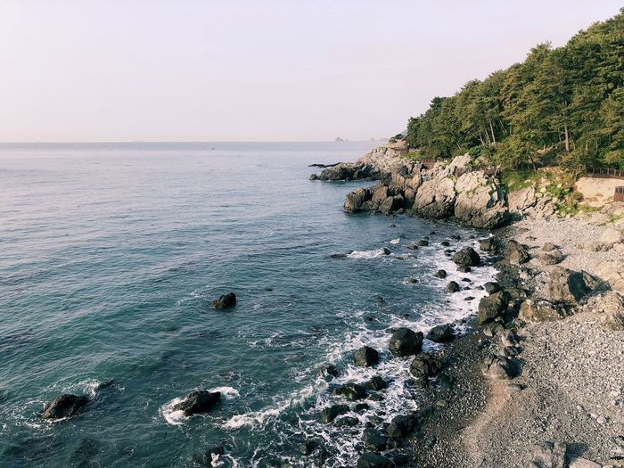 Beach Beauty In Nature Horizon Horizon Over Water Idyllic Land Motion Nature No People Non-urban Scene Outdoors Rock Rock - Object Rocky Coastline Scenics - Nature Sea Sky Solid Tranquil Scene Tranquility Water