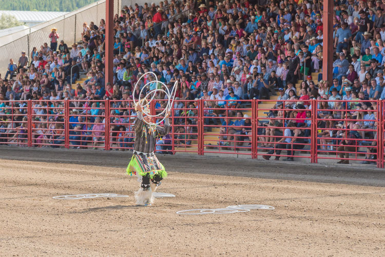 Williams Lake, British Columbia/Canada - July 2, 2016: three time world champion Alex Wells performs a traditional hoop dance at the 90th Williams Lake Stampede. 90th Williams Lake Stampede Afternoon Alex Wells Arena Dancing First Nations July Man Performer  Tradition Travel Annual Event Crowd Culture Hoop Dance Hoop Dancing Male Outdoors People Performance person Stampede Grounds Summer Tourism World Champion