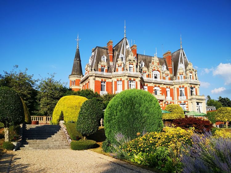 Clear Sky Blue Sky Architecture Building Exterior Built Structure Blooming Palace Topiary In Bloom