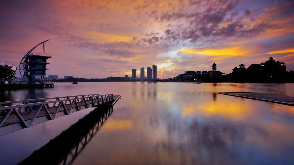 Sunrise view at the jetty in Pullman, Putrajaya, Malaysia. Architecture Beauty In Nature Building Exterior Built Structure City Cityscape Cloud - Sky Day Malaysia Modern Nature No People Outdoors Pullman Putrajaya Reflection Sky Skyscraper Sunrise_sunsets_aroundworld Sunset Travel Destinations Urban Skyline Water Waterfront