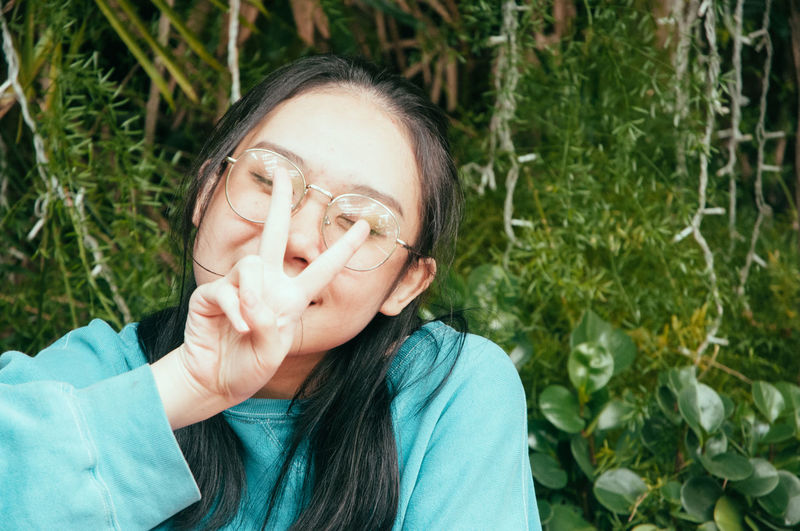 Portrait of teenage girl with plants