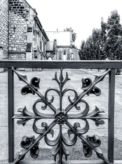 Black And White Streetphotography No People Check This Out Taking Photos Ironwork  Iron Detail OldFence Pattern Pattern, Texture, Shape And Form Patterns And Shapes Design Designs Fences Gates & Fences Fences & Gates Gates&fences Fences&gates Fence Wrought Iron Fences Church Yard Church Yards ChurchFences Church Fence Blackandwhite Close-up Wrought Iron Iron - Metal Iron